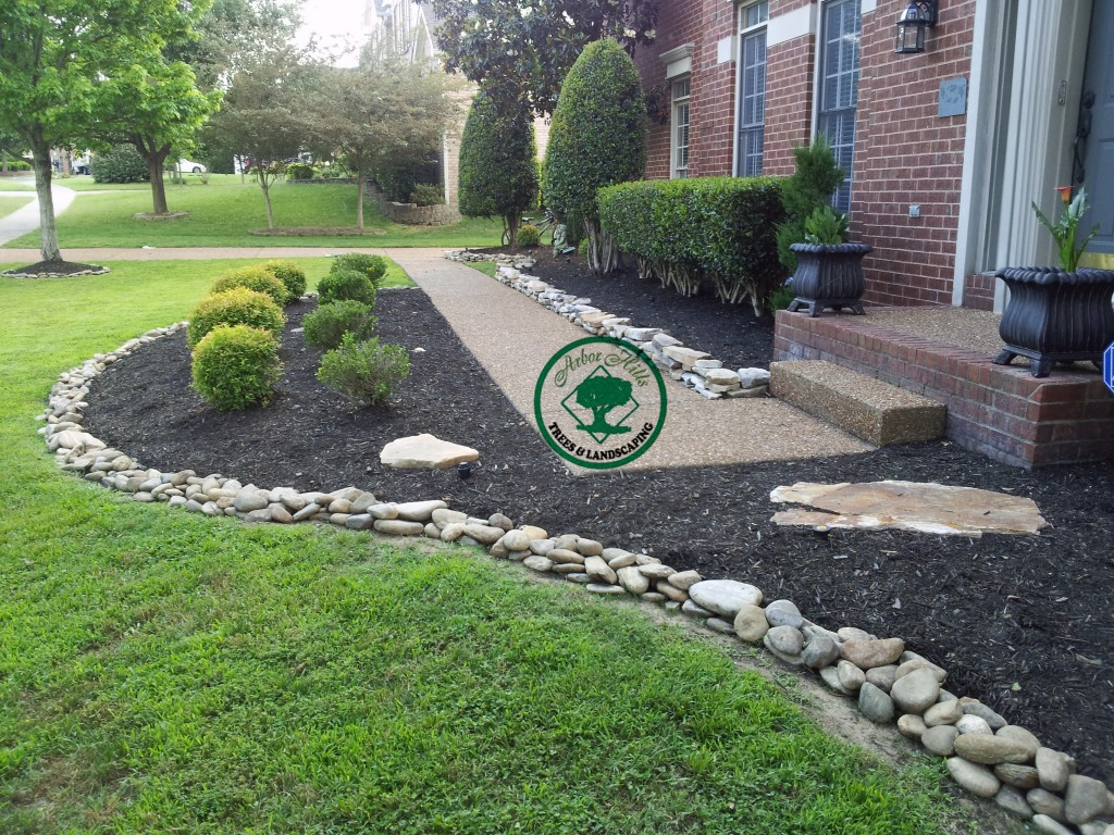 River Rock vs Mulch Landscaping